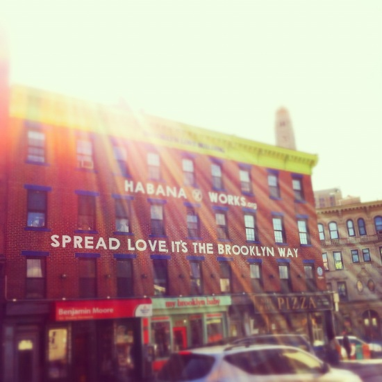 "iphoneography, instagram, iphone 4 photo of ""spread love, it's the brooklyn way"" sign, habana outpost, fort greene brooklyn, NY, sun flare"