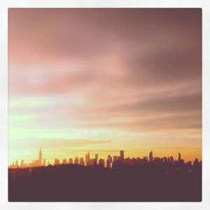 an iphone 4, instagram photo of the sunset over the new york city, NYC skyline