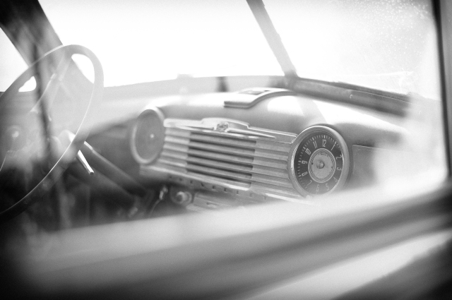 vintage chevy dreams, road trip imagery, black and white fine art photograph through the window of a vintage chevrolet automobile